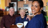 Home health care worker and an elderly couple